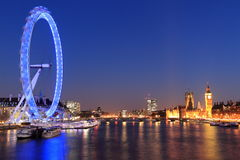 London. The London Eye, river Thames and Houses of Parliament at night in London, England Royalty Free Stock Photo