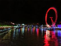 London Eye and river Thames at night stock photo