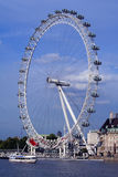London Eye. By the River Thames with ship and buildings Stock Photography