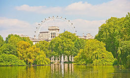 London Eye from St James Park. The London Eye viewed from across the lake in Saint James Park Royalty Free Stock Images