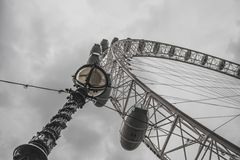 London Eye and streetlight from below in a cloudy English sky Stock Photography