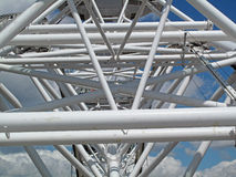 London Eye Structure. A photo taken going up in the Eye in London England. The blue sky and clouds give a great sense of height at the top. The people seen in Stock Photos