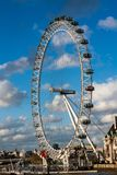London eye on a sunny day. Turist atraction, blue sky, clouds, city central Stock Photography