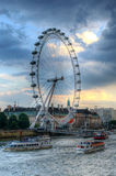 London eye at sunset - HDR. London eye and the Thames river at sunset in London, England Royalty Free Stock Photo