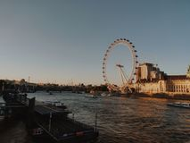 The London Eye during the sunset stock images