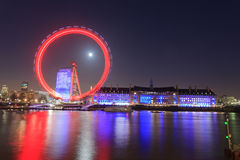London Eye is the tallest Ferris wheel in Europe at 135 meters and Country Hall in London Royalty Free Stock Photography