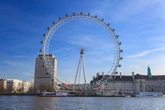 London Eye is the tallest Ferris wheel in Europe at 135 meters and Country Hall in London Stock Photos
