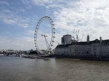 London Eye and the Thames. The London Eye is the most popular attraction of the UK and the tallest Ferris Wheel in Europe at 135 meters & x28;443 feet& x29 Royalty Free Stock Photography