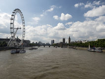 London Eye and the Thames. The London Eye is the most popular attraction of the UK and the tallest Ferris Wheel in Europe at 135 meters & x28;443 feet& x29 Stock Images