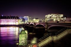 Westminster Bridge in London at night. The London eye and the Thames river lit up at night Royalty Free Stock Photography