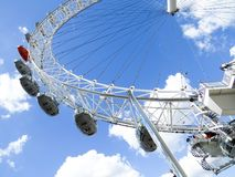 The London Eye on the Thames River in London. The London Eye is the most popular attraction of the UK and the tallest Ferris Wheel in Europe Royalty Free Stock Photo