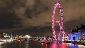 London Eye and Thames River at Night royalty free stock photos