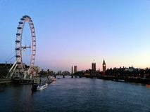 London. Eye, the Thames river and parliament Stock Image