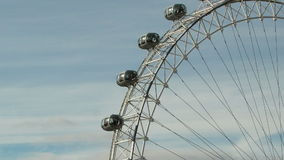 London eye tilt down left zoom out timelapse stock video footage
