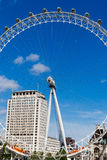 London Eye. The London eye tourist attraction in London, England. This is on a sunny day and the wheel would have been very busy, do to the clear skies royalty free stock photos
