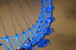 London Eye, UK. London Eye panoramic wheel close up at dramatic sky with light pollution in London, UK, middle angle shoot, long expositure royalty free stock images