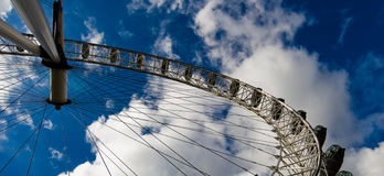 London eye under blue sky. The famous london eye observed from an different angle Royalty Free Stock Photo