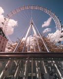 London Eye from a Unique Perspective Wide Angle. Unique perspective of the London eye in London, UK. Leading lines bring the eye to the center of the eye with a royalty free stock images