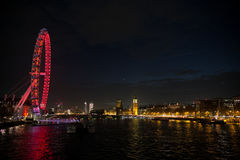 London Eye view at night. Night lights at London Eye from the river Thames Royalty Free Stock Photography
