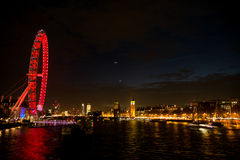 London Eye view at night. Night lights at London Eye from the river Thames Royalty Free Stock Images