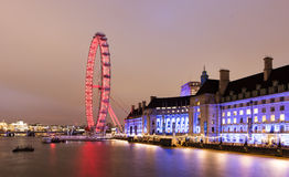 London Eye viewed at night. London Eye illuminated at night viewed from Westminster Bridge, England royalty free stock photography