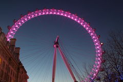 London Eye in Waterloo, London - February 15th of 2015: This is the third largest ferris wheel all around the world. This tourist attraction is 135 meters tall stock photo