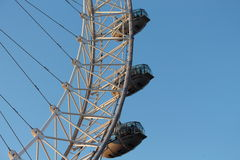 London Eye in Waterloo, London - February 15th of 2015: This is the third largest ferris wheel all around the world. This tourist attraction is 135 meters tall stock photography
