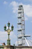 The London Eye and Westminster Bridge Royalty Free Stock Images