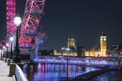 London Eye and Westminster at night  - London England  UK. London Eye and Westminster at night  - London England - United Kingdom Royalty Free Stock Photography