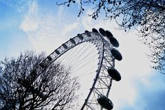 London Eye. Wheel with blue cloudy sky in the backround Royalty Free Stock Images