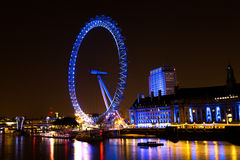 The London Eye wheel and county hall at night Stock Photo