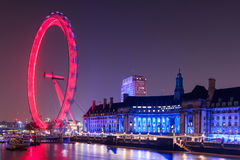 London Eye wheel on River Thames at night. Iconic view of the London skyline at night stock photography