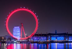 London Eye wheel on River Thames skyline at night. Iconic view on the River Thames in London stock photography