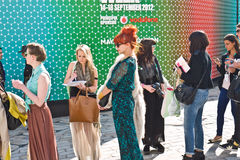 London Fashion Week at Somerset House. LONDON, UK-SEPTEMBER 14: Fashionable visitors que for the cat walk shows at the internationally famous London'Fashion Week Royalty Free Stock Photography