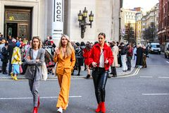 LONDON - FEB 16, 2018: Fashionista attend Fashion Scout during the London Fashion Week February 2018 collections at Freemasons` stock photo