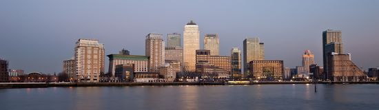 London financial district panoramic skyline 2013. At sunset. Long exposure of Canary Wharf, Financial District CBD in London Royalty Free Stock Photo