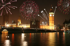 London fireworks. Night view of House of Parliament and Big Ben in London with fireworks on New Years Eve Stock Images