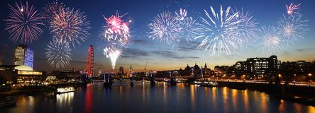 London skyline, night view, fireworks over Hungerford Bridge and Stock Photos