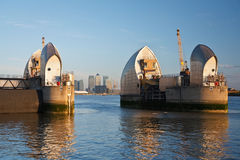 London flood barrier and Canary Wharf.. Stock Photography