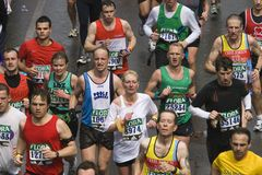London Flora Marathon. Men and Women struggling to run the 26m course Royalty Free Stock Photo