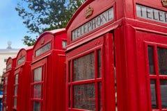 London gamla röda telefonaskar Royaltyfria Bilder