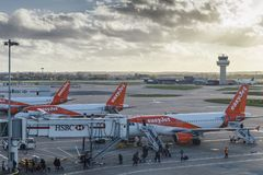 Passengers disembark from an Easyjet airplane at London`s Gatwick airport. London Gatwick, UK - Nov 23rd, 2017: Passengers disembark from an Easyjet airplane at Stock Images