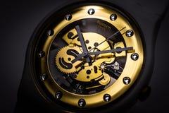 London, GB 07.10.2020 - Swatch swiss made quartz watch on black backdrop