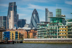 London Gherkin building. The Gherkin building and other commercial and residential properties in London as seen from the river Thames, UK Royalty Free Stock Images