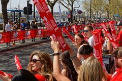 Red crowd at the London Marathon. LONDON, GREAT BRITAIN, April 22, 2018 : Crowd along the track of Marathon. The 2018 London Marathon was the 38th annual mass Stock Image