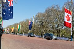 The Mall and Commonwealth flags. LONDON, GREAT BRITAIN, April 19, 2018 : The Mall is the landmark ceremonial approach road to Buckingham Palace Royalty Free Stock Photo
