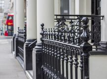 London, Great Britain.Kensington street. Metal fence on one of the houses. stock photos