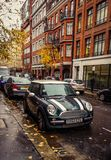 Green Mini cooper parked in the street stock photography