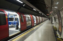 Nice details with train and open doors in Subway under London stock photos