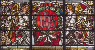 LONDON, GREAT BRITAIN - SEPTEMBER 14, 2017: The angels with the IHS initials on the stained glass in church St. Vedast alias Foste Stock Photography